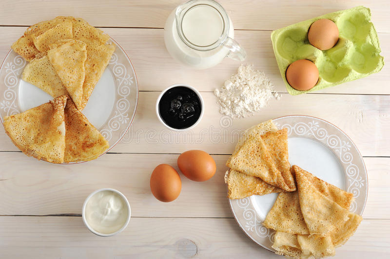 a kit for making pancakes, eggs, milk, pitcher, flour, sour cream and jam stock image