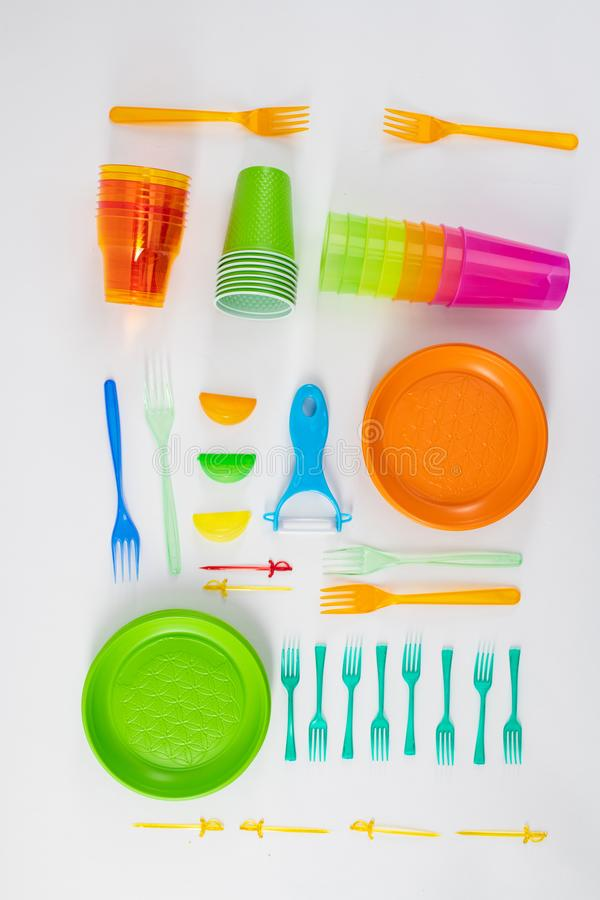 Kit of plastic utensils accurately placed on the floor. Bright bunch. Kit of plastic utensils accurately placed on the floor as installation for mindful using royalty free stock images