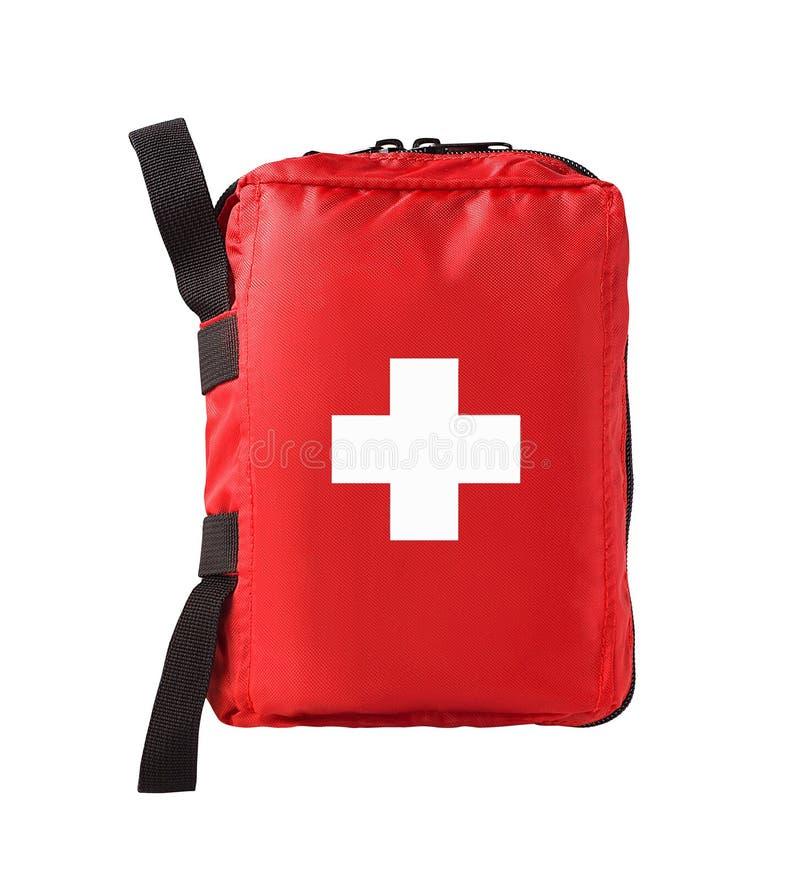Kit rouge de premiers secours avec le symbole croisé photographie stock libre de droits