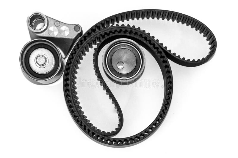 Kit of timing belt with rollers on a light background stock photos