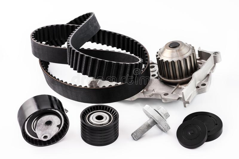 Kit of timing belt with rollers and pump on a white background. Spare parts for the car. The set of timing belt with rollers and cooling pump on a white stock image