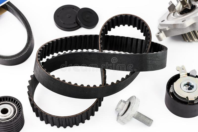 Kit of timing belt with rollers and pump on a white background royalty free stock photos