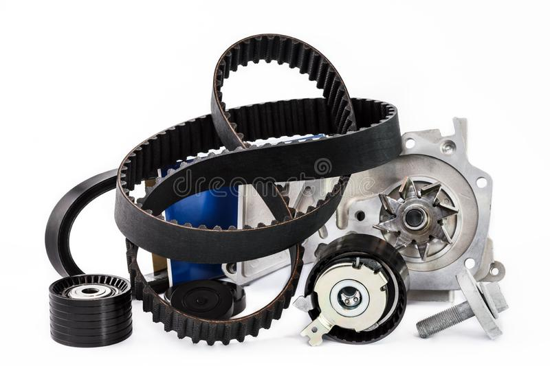 Kit of timing belt with rollers and pump on a white background royalty free stock photo