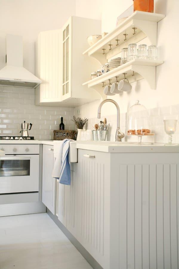 Stylish modern white kitchen royalty free stock image