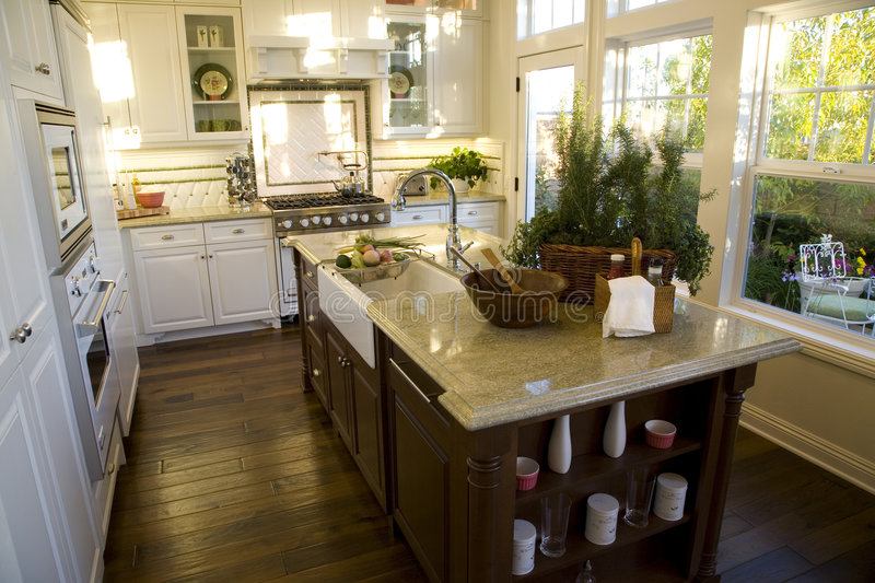 Kitchen 2580. Modern kitchen with a hardwood floor and island stock images