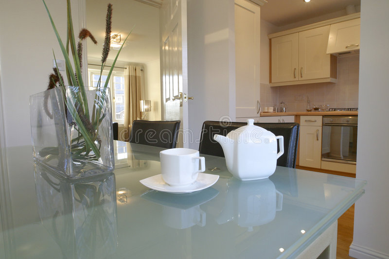 Kitchen. Interior in modern apartment with wood fittings and glass table stock photography