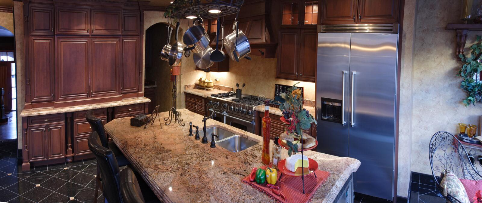 Kitchen. Exclusive kitchen with granite countertops royalty free stock photography