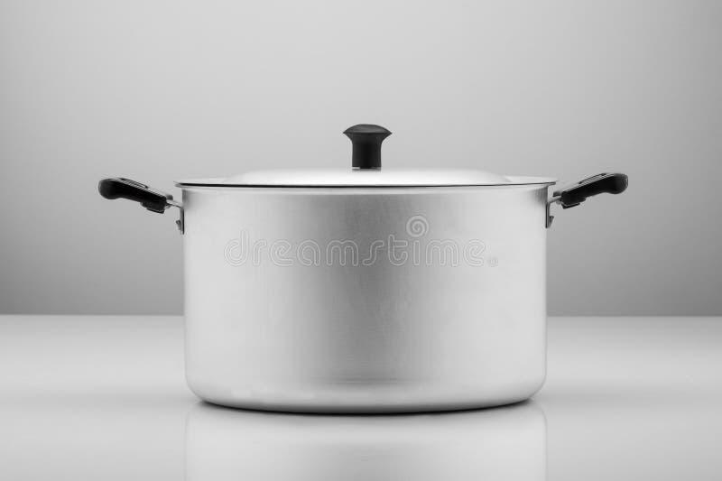 Kitchen pan on a light background royalty free stock photos