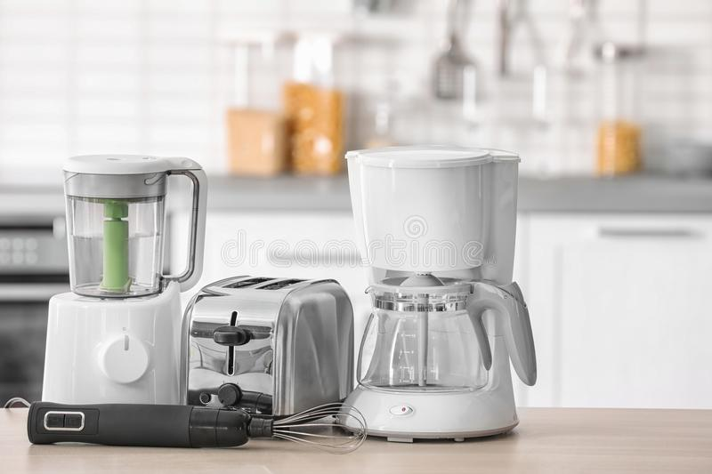 Kitchen appliances on table. Against blurred background stock photography