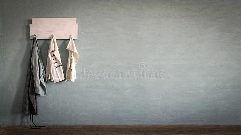 Kitchen, aprons hang, hanger, kitchen wall, Concept, kitchen, cooking, restaurant, bakery,  Copy space, for text. Kitchen aprons hang on a hanger on the kitchen royalty free stock images
