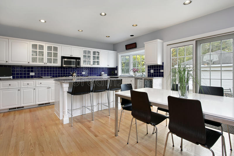 Kitchen with blue tile backsplash stock photos