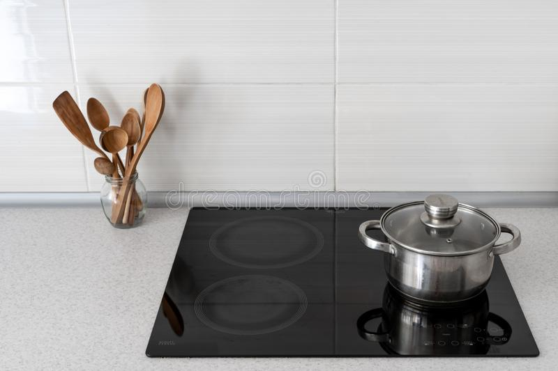 Kitchen with built in ceramic induction stove stock photography