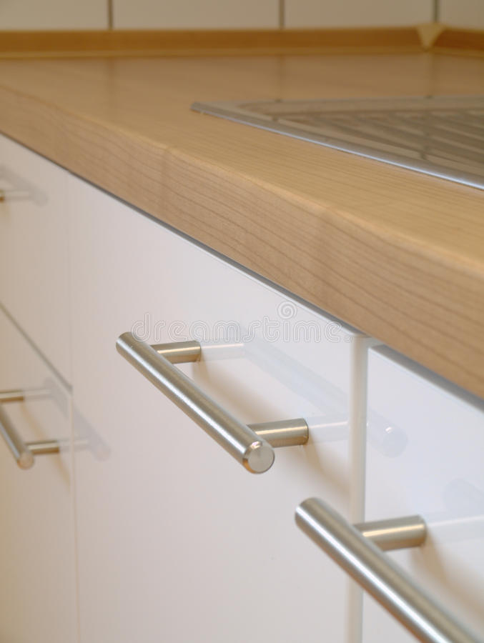 Kitchen cabinet. A modern kitchen (cabinet, counter top, sink stock image