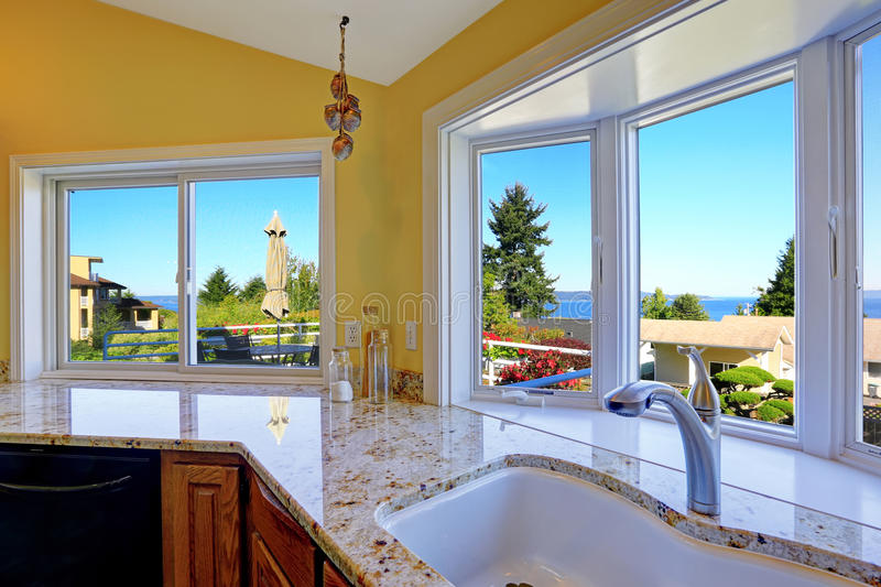 Kitchen cabinet with granite tops and beautiful window view stock images