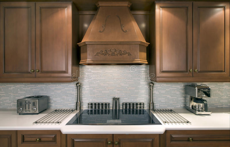 Kitchen cabinets and cooktop stock image
