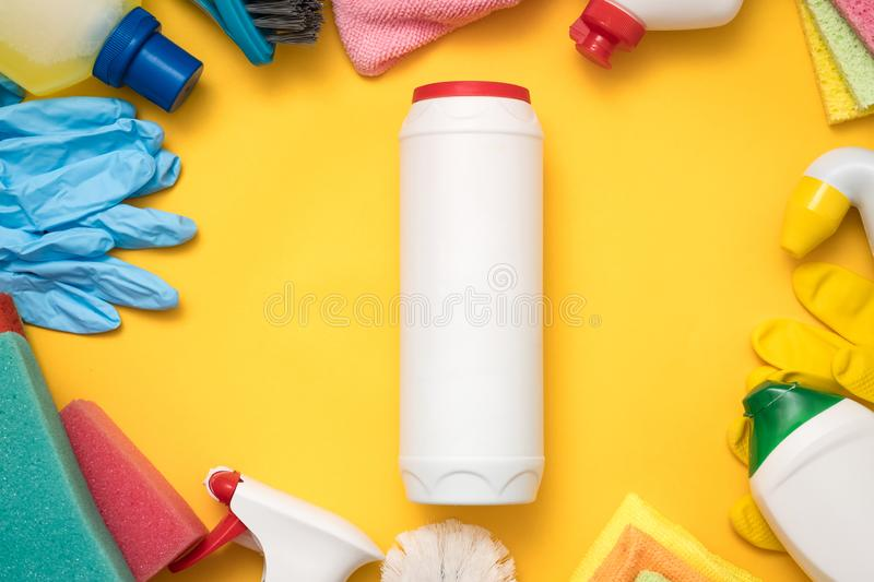 Kitchen cleaning advertise supplies bottle mockup. Quality kitchen cleaning. Advertising concept. Plastic bottle mockup and supplies frame on yellow background stock photography