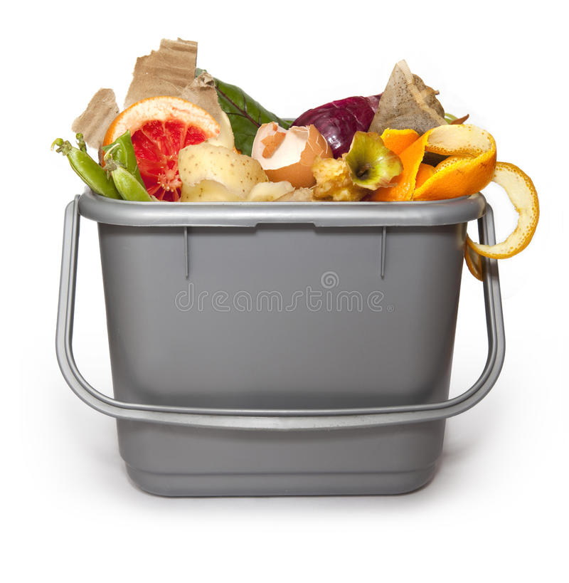 Kitchen composting bin. Isolated Kitchen composting bin with all manner of compostable things stock image