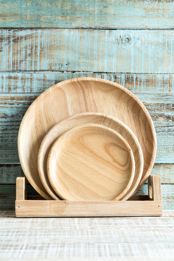Kitchen cooking utensils in storage on the wood background stock photo