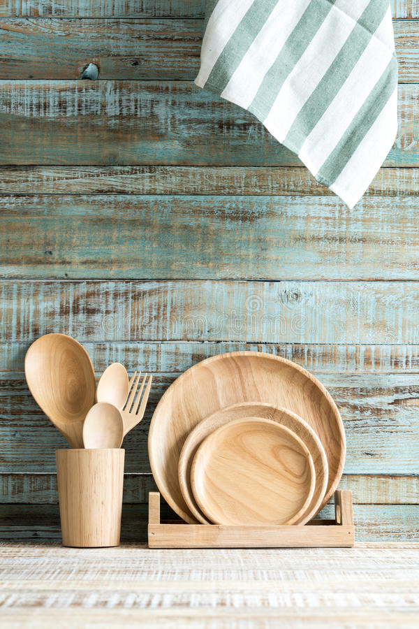 Kitchen cooking utensils in storage on the wood background stock image