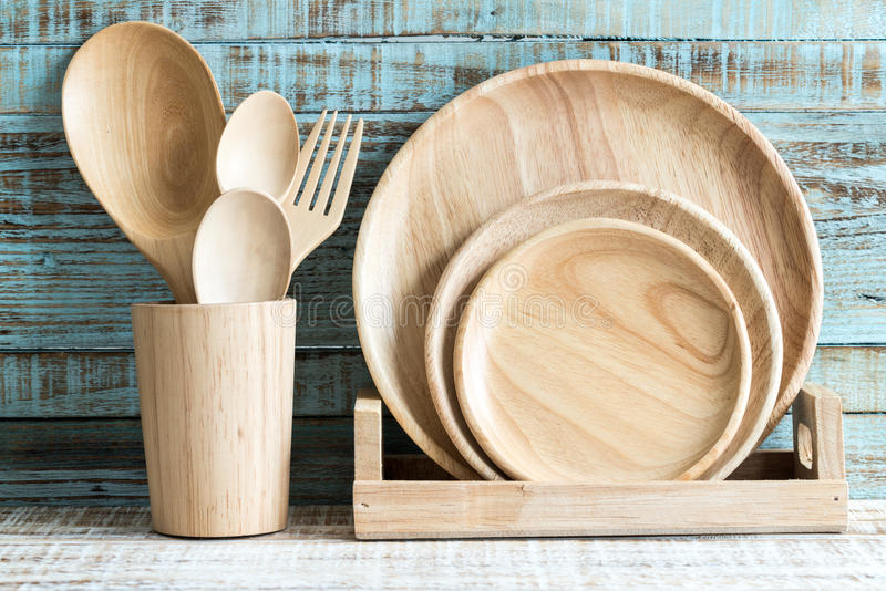 Kitchen cooking utensils in storage on the wood background royalty free stock photos