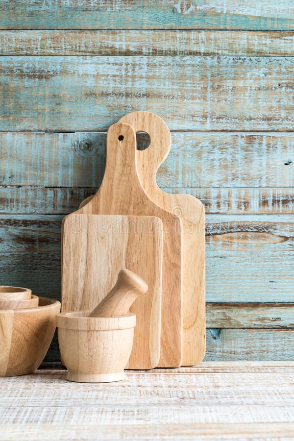 Kitchen cooking utensils in storage on the wood background stock photography