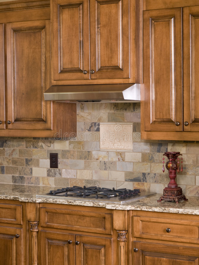 Kitchen cooktop and cabinets. Angle view stock photography