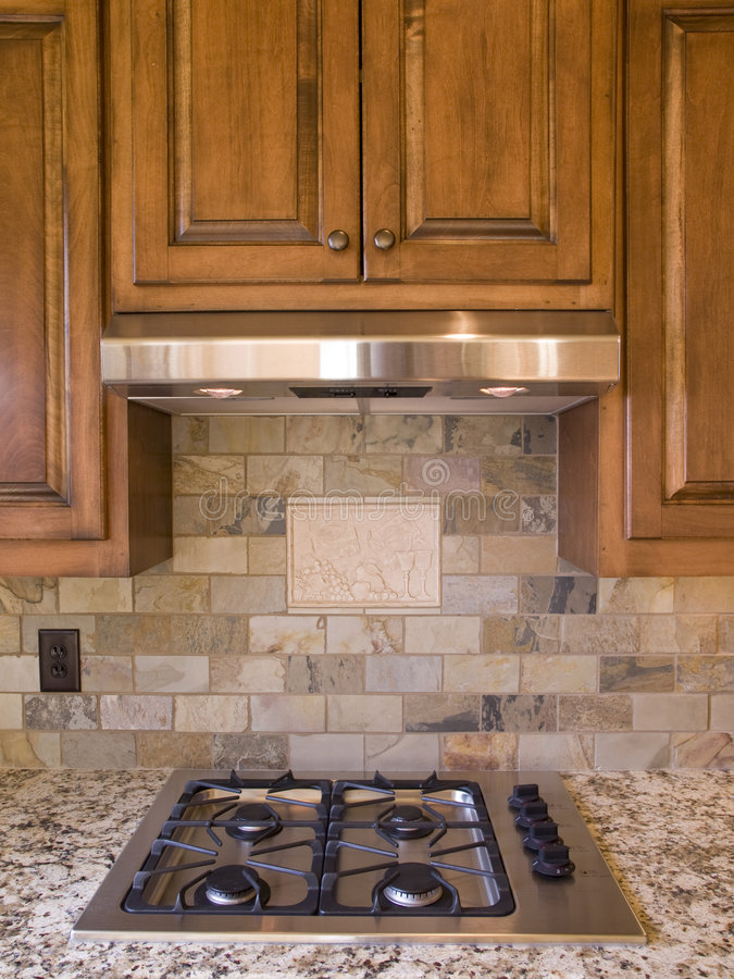 Kitchen cooktop and cabinets front view. Kitchen cooktop and wood cabinets front view royalty free stock images