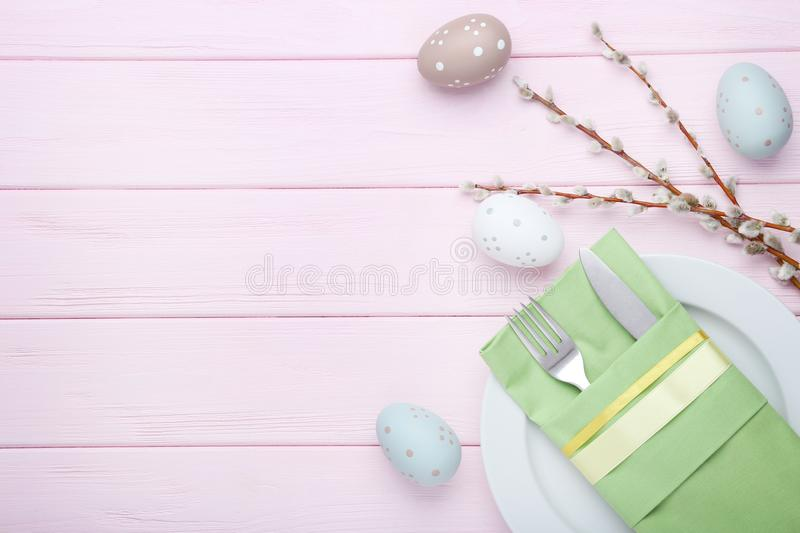 Kitchen cutlery with easter eggs stock images
