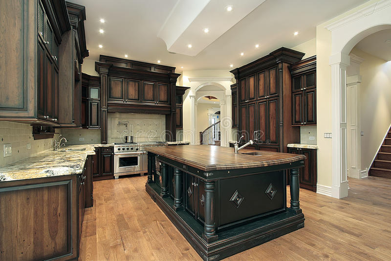 Kitchen with dark cabinetry stock images