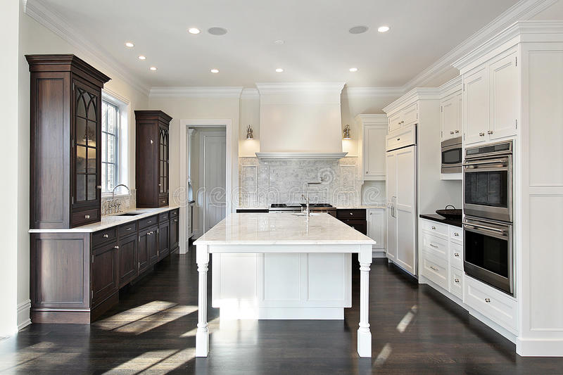 Kitchen with dark and light cabinetry royalty free stock photo