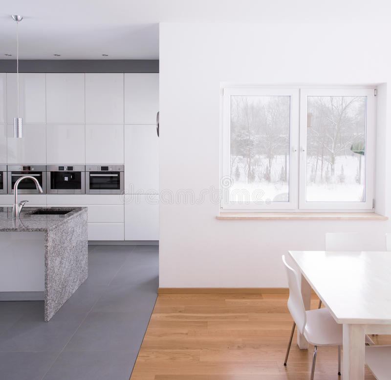 Kitchen and dining hall. Modern kitchen connected with dining hall stock photos