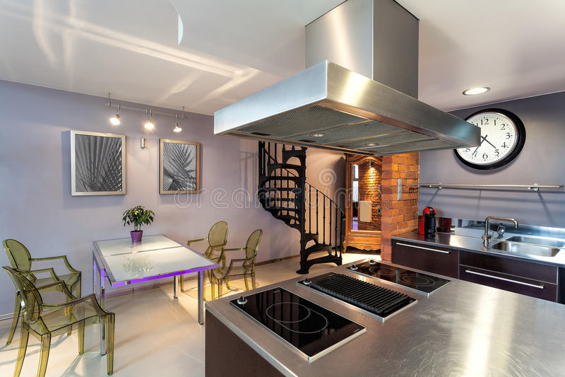Kitchen and dining room. Modern original kitchen and dining room interior stock image