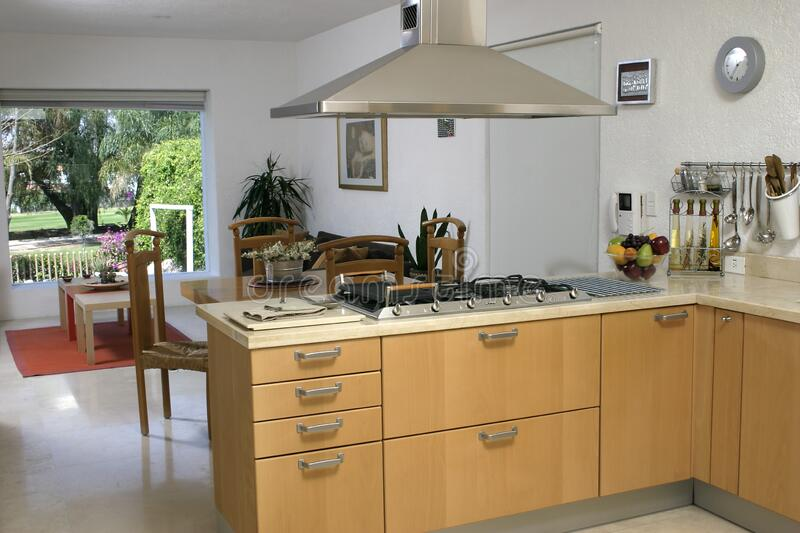 Kitchen and dining room view of a modern house royalty free stock images