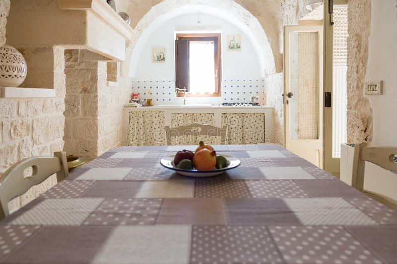 Kitchen and dining table in a an old trullo of Puglia, Italy royalty free stock images