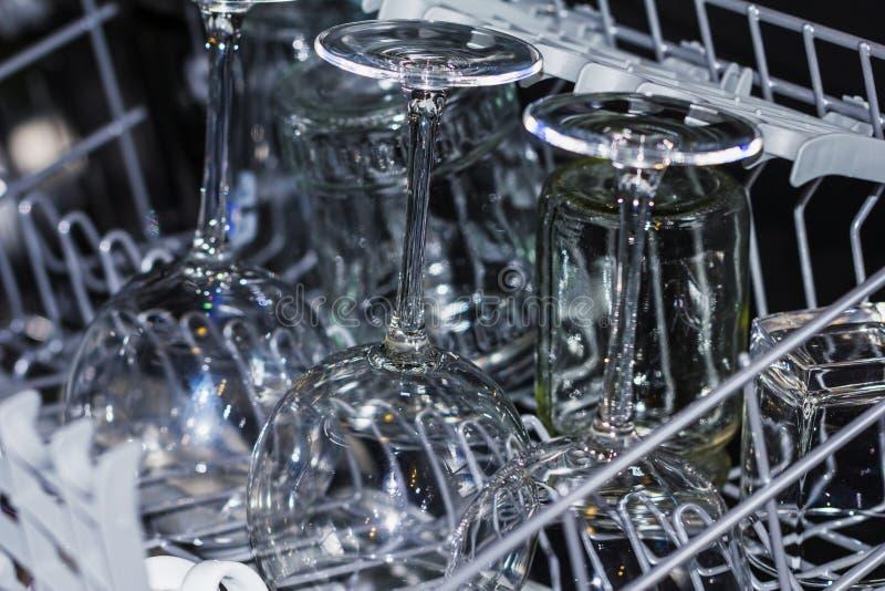 Kitchen dishwasher with wine glasses royalty free stock photos