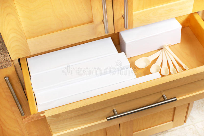 Kitchen drawer. Remember, when renovating, plan for a six inch drawer to hold all those plastic bag, foil and parchment wrap containers royalty free stock photos
