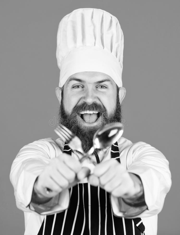 Kitchen equipment. Chef man in hat. Secret taste recipe. Vegetarian. Mature chef with beard. Dieting and organic food royalty free stock images