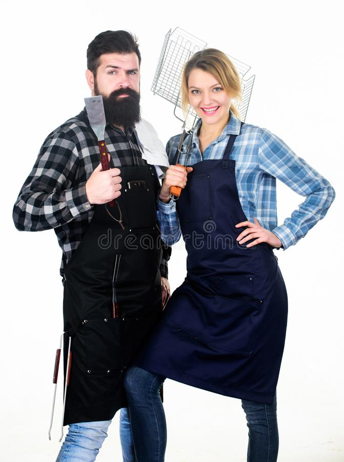 Kitchen equipment. Family weekend. Couple in love hold kitchen utensils. Man bearded hipster and girl. Preparation and stock photos