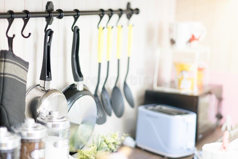 Kitchen equipment are hung on the wall royalty free stock images