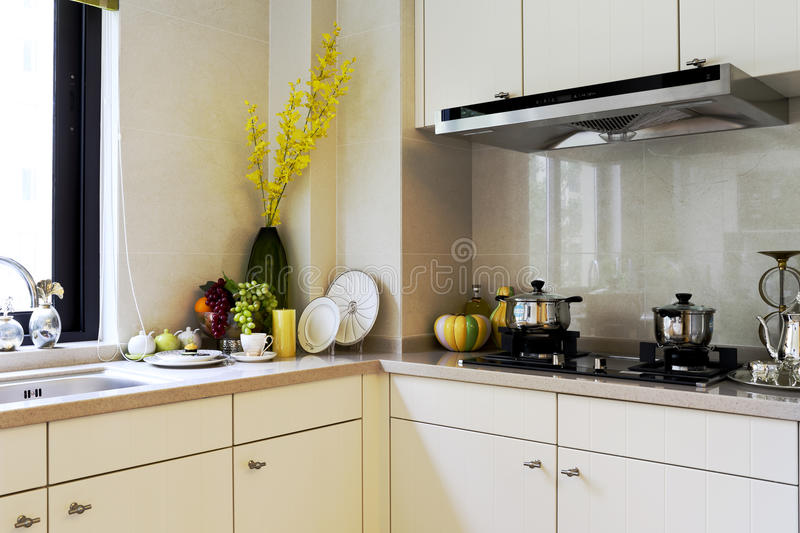 The kitchen of example room. Chinas apartment kitchen stove and cooking utensils stock image