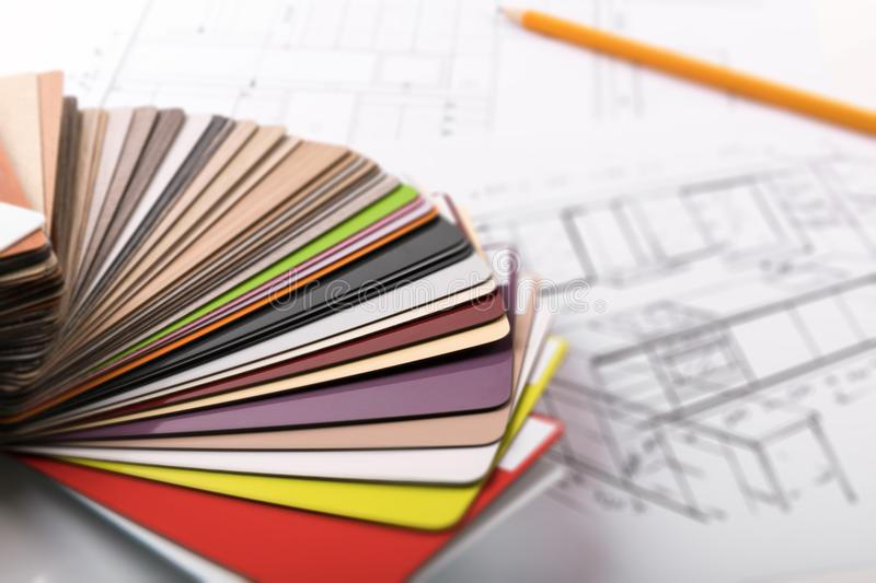Kitchen furniture design - material samples on project sketch royalty free stock image
