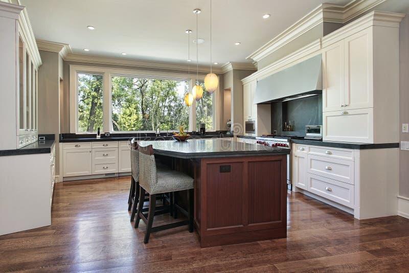 Kitchen with gray granite island stock photos