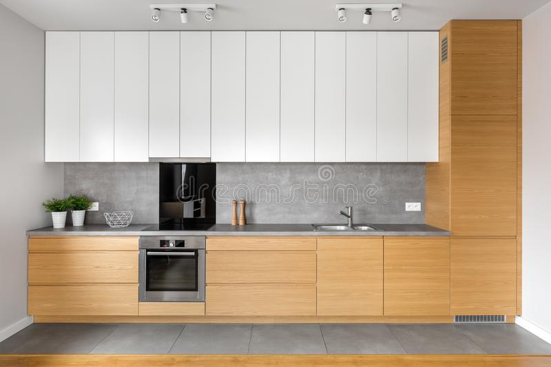 Kitchen with grey tiling stock image