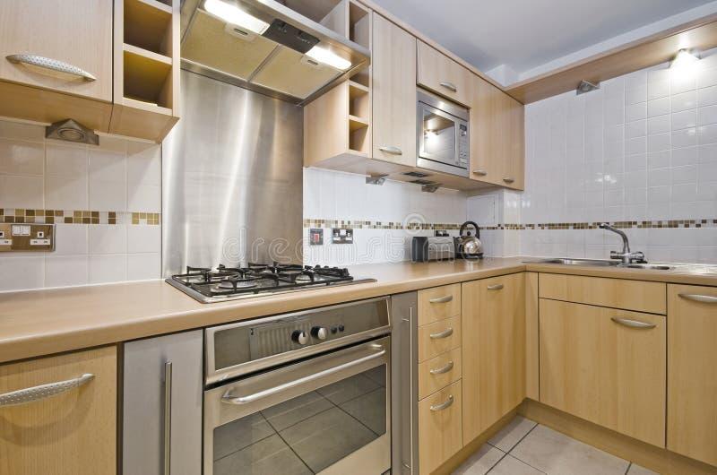 Kitchen with hard wood unit stock image