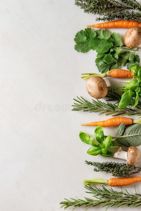 Kitchen herbs and carrots stock photo