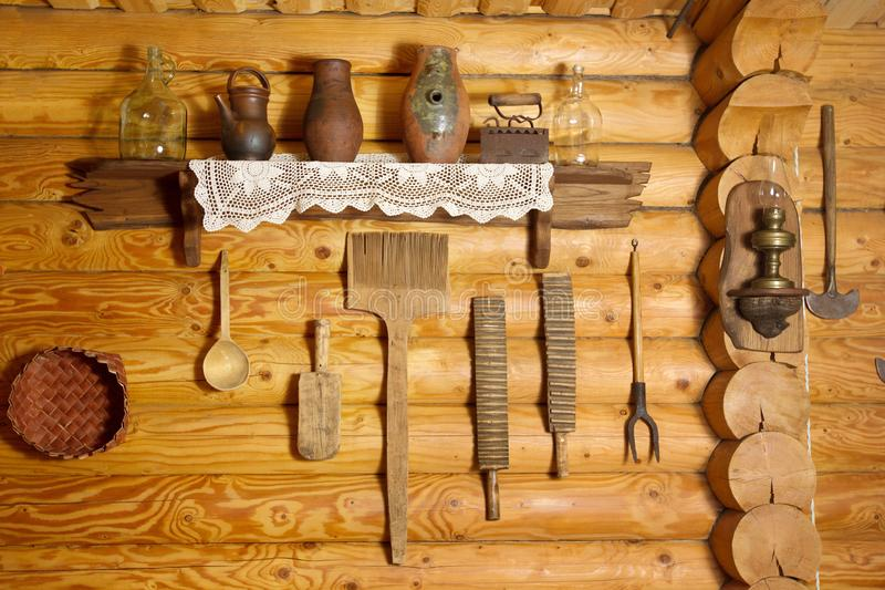 Kitchen in the house of a poor peasant in the old Russian style. Log wall royalty free stock photos