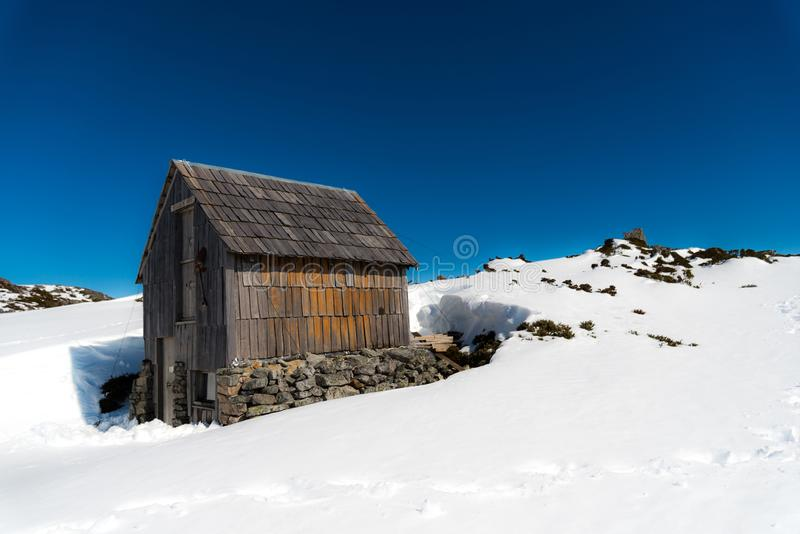 Kitchen hut on Cradle Mountain in winter. Wooden kitchen hut was surrounded by snow in winter royalty free stock photography