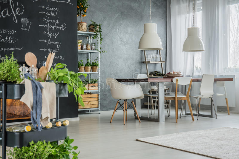 Kitchen with industrial dining area stock images