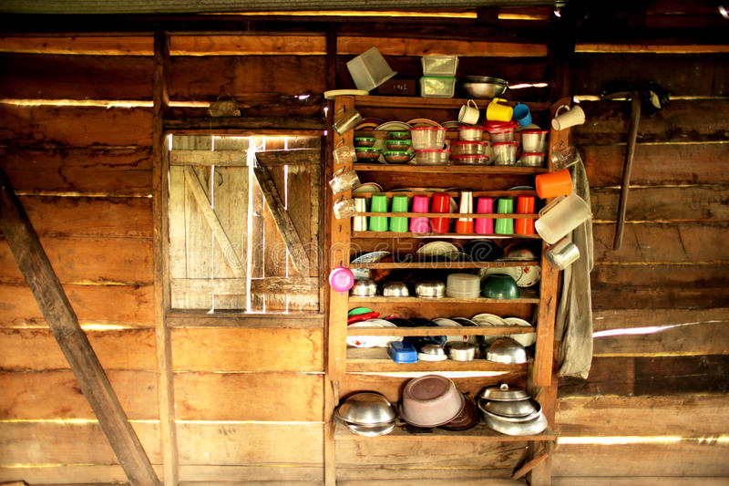 A Kitchen Interior in Central America. A Kitchen Interior in a Hut in Central America with Wooden Slats and a Shelf with Pots and Pans and a Window stock photo