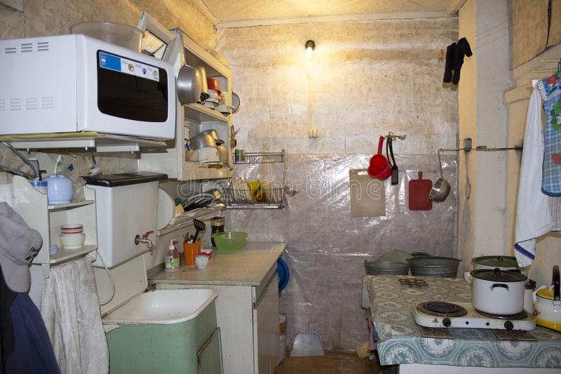 Kitchen interior with dishes in an old Russian house. Kitchen interior with sink and dishes in an old Russian house stock photo